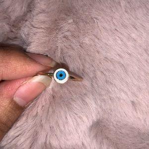 Accessorize evil eye ring.